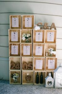 tableau de marriage creative seating chart candles wine boxes